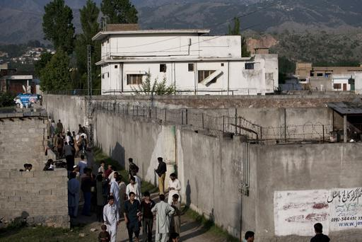 ABBOTTABAD, PAKISTAN - MAY 3: People gather outside Osama Bin Laden's compound, where he was killed during a raid by U.S. special forces, May 3, 2011 in Abottabad, Pakistan. Bin Laden was killed during a U.S. military mission May 2, at the compound. According to reports May 4, 2011, the Obama administration has decided not to release photographs of Bin Laden's body. (Photo by Getty Images)