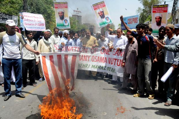 Pakistani protesters burn representation of a U. S. flag during a rally to condemn the killing of al-Qaida leader Osama bin Laden, in Multan, Pakistan on Wednesday, May 4, 2011. Pakistan criticized the American raid that killed Osama bin Laden as an