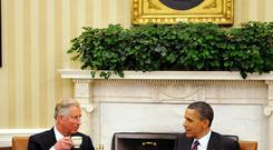 The Prince of Wales drinks tea while meeting US President Barack Obama in the Oval Office of the White House