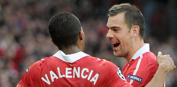 Manchester United's Antonio Valencia (left) and Darron Gibson celebrate Valencia's goal during the UEFA Champions League, Semi Final, Second Leg at Old Trafford, Manchester.