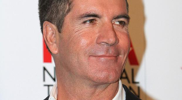 Simon Cowell has been listed in the top 10 music millionaires in Britain