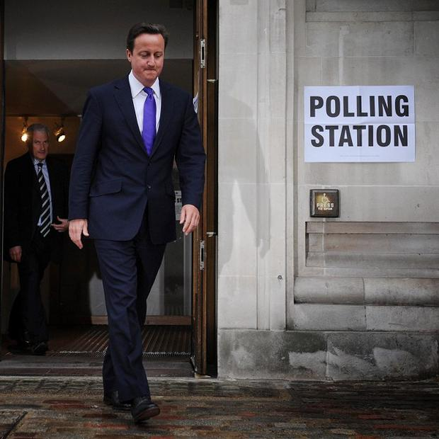 David Cameron leaves a polling station in Westminster, after casting his vote (PA)