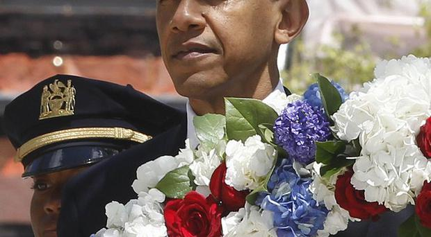 President Barack Obama lays a wreath at the National September 11 Memorial at Ground Zero in New York