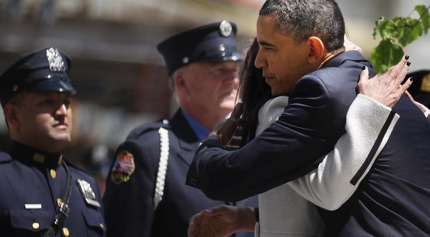 NEW YORK, NY - MAY 05: U.S. President Barack Obama hugs Diane Wall, whose husband Glen Wall perished in the twin towers on 9-11, at a wreath laying ceremony at Ground Zero May 5, 2011 in New York City. Obama also visited a New York Fire Department firehouse and met with families of victims of the terrorist attack on September 11, 2001during his visit to New York. (Photo by Mario Tama/Getty Images)