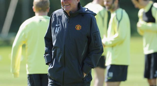 Manchester United manager Sir Alex Ferguson wants to stay cool, but he is finding it pretty difficult