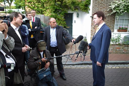 LONDON, ENGLAND - MAY 06: Liberal Democrat Party leader Nick Clegg speaks to reporters outside his house on May 6, 2011 in London, England. The Liberals have suffered losses in the local elections held yesterday. (Photo by Peter Macdiarmid/Getty Images)