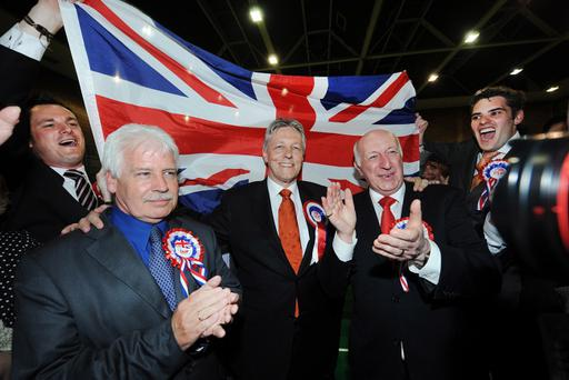 First Minister and DUP leader Peter Robinson celebrates topping the poll in the east Belfast count at Newtownards Leisure Centre in the Northern Ireland Assembly elections