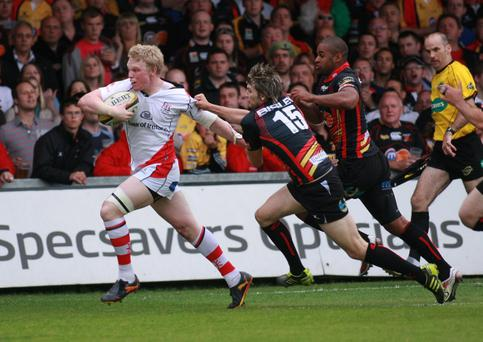 Ulster's Nevin Spence shows his opponents a clean pair of heels during last night's Magners League victory over the Dragons
