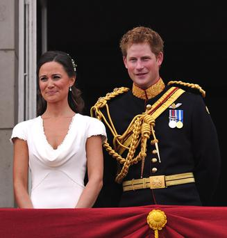 Pippa Middleton and Prince Harry appear on the balcony of Buckingham Palace, London, following the wedding of Prince William and Kate Middleton at Westminster Abbey