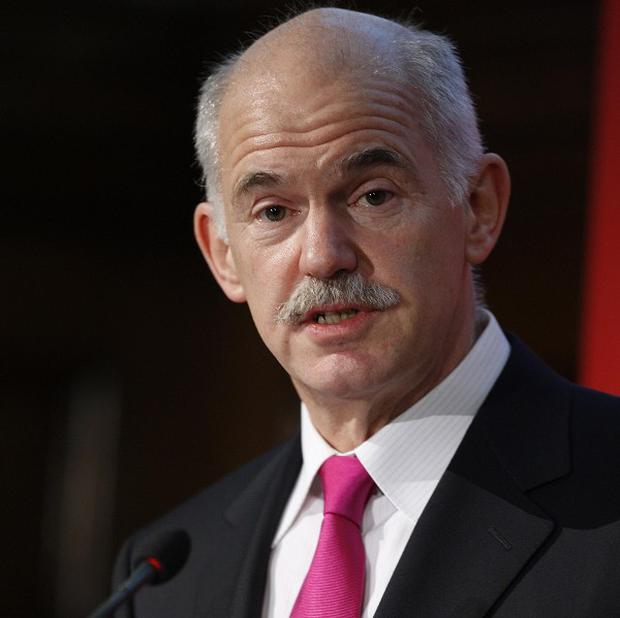 Greek Prime Minister George Papandreou has criticised a report claiming his country wants to quit the eurozone (AP)