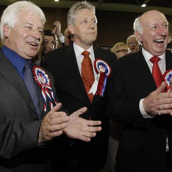 DUP leader Peter Robinson celebrates his election to the East Belfast constituency with supporters at Ards Leisure centre