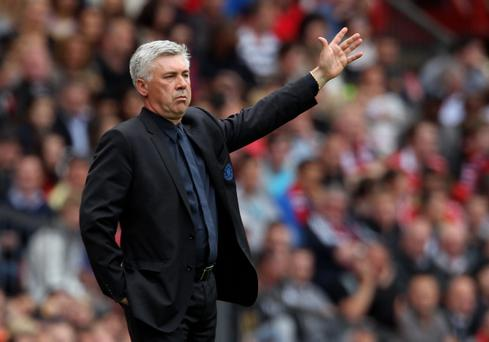 MANCHESTER, ENGLAND - MAY 08: Chelsea Manager Carlo Ancelotti gestures during the Barclays Premier League match between Manchester United and Chelsea at Old Trafford on May 8, 2011 in Manchester, England. (Photo by Alex Livesey/Getty Images)