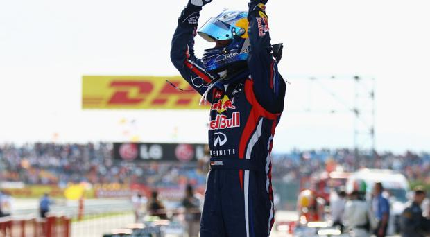 ISTANBUL, TURKEY - MAY 08: Sebastian Vettel of Germany and Red Bull Racing celebrates in parc ferme after winning the Turkish Formula One Grand Prix at the Istanbul Park circuit on May 8, 2011 in Istanbul, Turkey. (Photo by Paul Gilham/Getty Images)