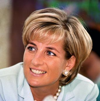 Two dresses worn by Princess Diana have sold for a record 168,000 pounds at a US auction