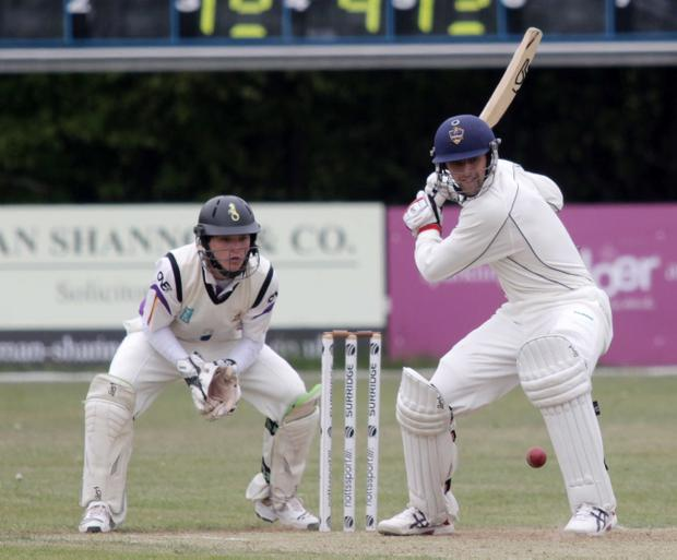 Waringstown's Obus Pienaar on his way to 81 against Instonians watched closely by wicket-keeper Rory McCann at Shaws Bridge