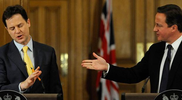 Nick Clegg (left) would 'never, never, never' join David Cameron and the Tory party, he has said