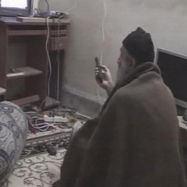 A man that the United States claims is Osama bin Laden is seen watching television in video footage released by the US government