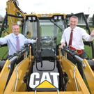 Colin McDonald, RUAS and Ian Jordan, Ulster Bank welcome back heavy plant and agricultural machinery exhibitor Finning to the Balmoral Show.