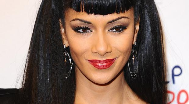 Nicole Scherzinger has topped a poll of the world's most beautiful women