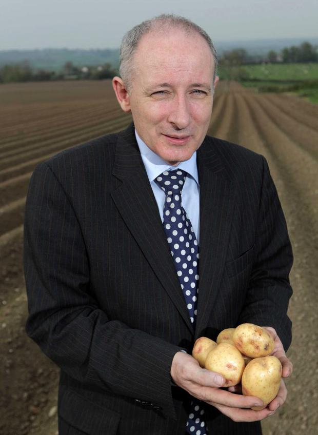 Lewis Cunningham, managing director of Wilson's Country, has his hands full, not just of his product but for orders after turning around the marketing of the potato industry.
