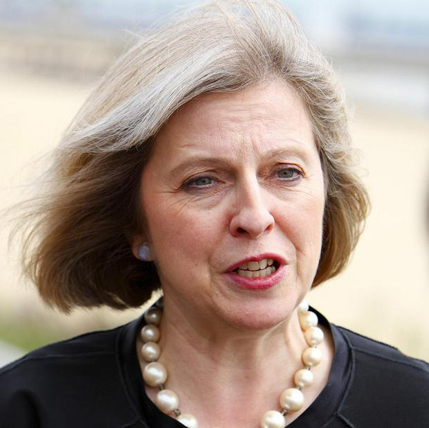 Home Secretary Theresa May said bailed suspects would be sent formal charges through the post