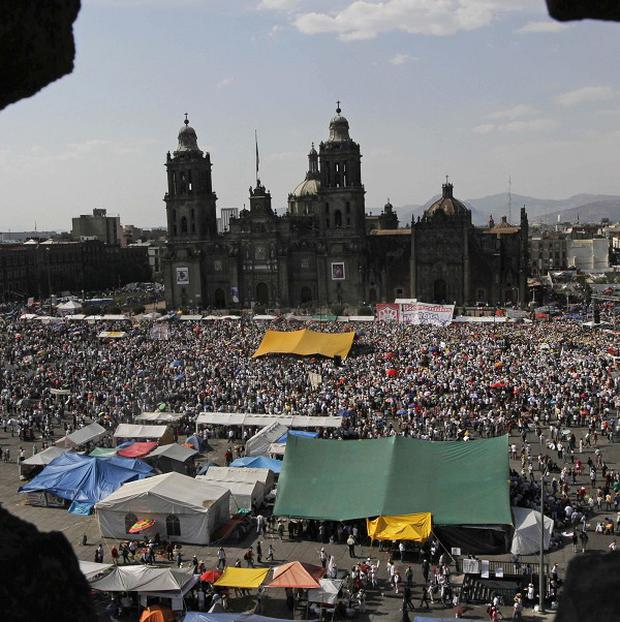 Thousands of people gather during a protest against violence at Mexico City's Zocalo plaza (AP)