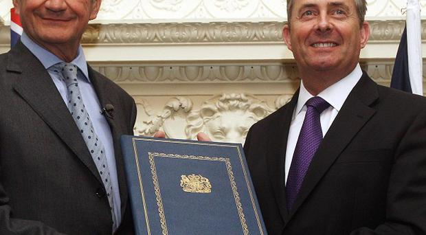 UK Defence Secretary Liam Fox (right) and his French counterpart Gerard Longuet