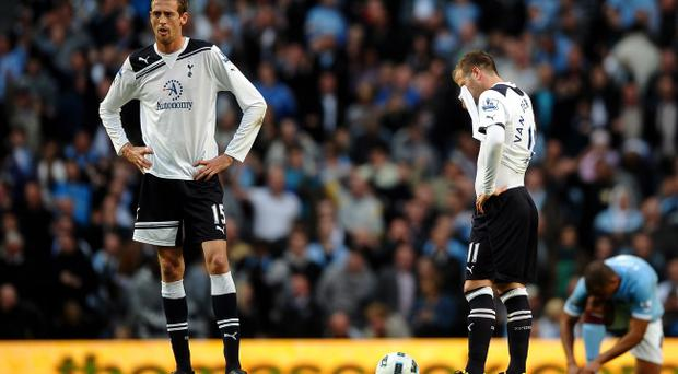 MANCHESTER, UNITED KINGDOM - MAY 10: Peter Crouch (L) of Tottenham Hotspur looks on dejectedly after scoring an own goal during the Barclays Premier League match between Manchester City and Tottenham Hotspur at the City of Manchester Stadium on May 10, 2011 in Manchester, England. (Photo by Laurence Griffiths/Getty Images)