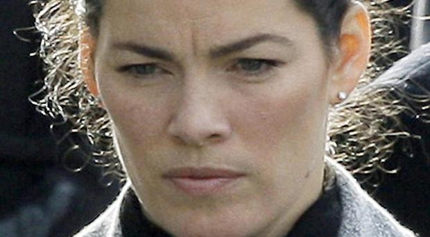 Olympic figure skater Nancy Kerrigan arrives for the funeral for her father Daniel Kerrigan (AP)