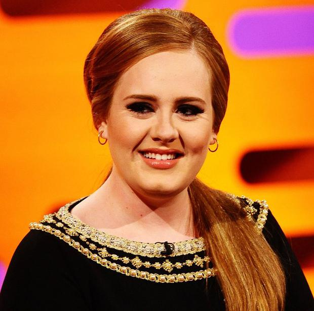 Adele has topped the album chart for a 14th week