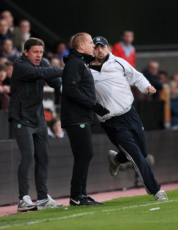 Celtic's Neil Lennon is attacked by a fan during the Clydesdale Bank Scottish Premier League at Tynecastle Stadium, Edinburgh
