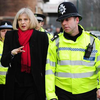 Home Secretary Theresa May has suffered a major defeat in the House of Lords on the flagship plan for elected police and crime commissioners