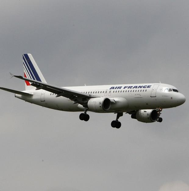 France's main airports have asked airlines to halve their number of flights as air traffic controllers strike in protest at plans to centralise control of Europe's airspace.