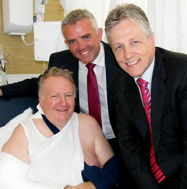 DUP leader Peter Robinson visits Cllr Eddie Thompson (left) with Strangford MLA Jonathan Bell