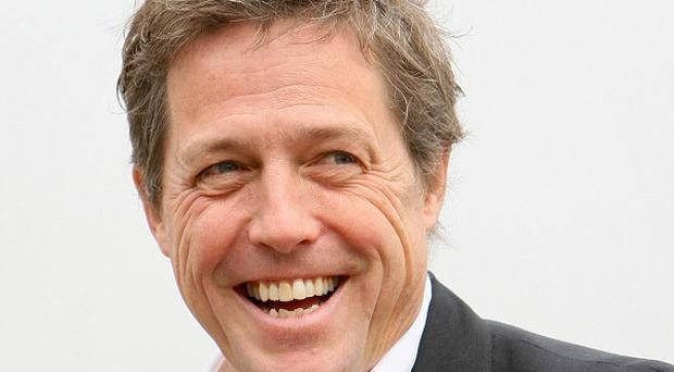 Hugh Grant has been weighing a big move: replacing the fired Charlie Sheen on Two and a Half Men