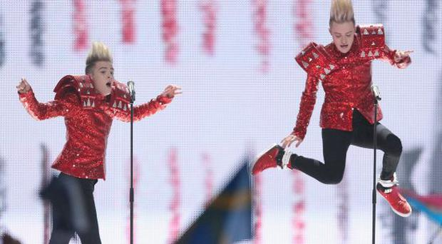 DUESSELDORF, GERMANY - MAY 12: John and Edward Grimes of the band Jedward from Ireland peform in the second semi-finals of the Eurovision Song Contest 2011 on May 12, 2011 in Dusseldorf, Germany. (Photo by Sean Gallup/Getty Images)