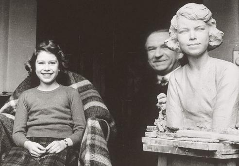 Picture dated 1935 showing Princess Elizabeth sitting in the studio of Hungarian sculptor Sigismund de Strobl (background).