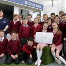 County Winners - Pictured with their entry in the community cow parade on the third day of the Balmoral Show in partnership with the Ulster Bank are pupils from Recarson primary school along with teacher Lisa O'Kane (left) and Principal Rita Fox (right). Also pictured is Karen McAleese from Ulster Bank.