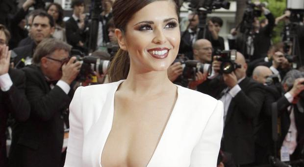X Factor judge Cheryl Cole takes to the red carpet at Cannes in an eye-catching little white number