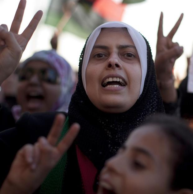 Women chant anti-Gaddafi slogans during a protest in Benghazi, Libya (AP)