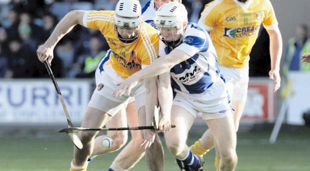 Sticking point: Laois' Brian Stapleton and Neil McManus of Antrim battle for possession on Saturday