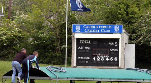 Under the covers: The wet weather had the final say in the Carrick v Merrion clash at Middle Road, Carrickfergus