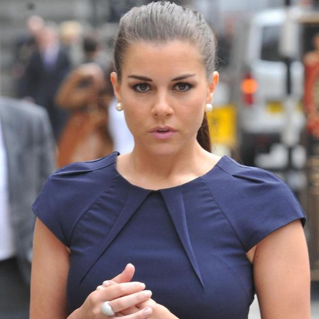 Imogen Thomas arrives at the High Court for a hearing linked to the injunction protecting the identity of a footballer with whom she had an affair