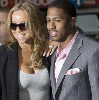 Nick Cannon said his twins arrived to the sound of mum Mariah Carey in concert