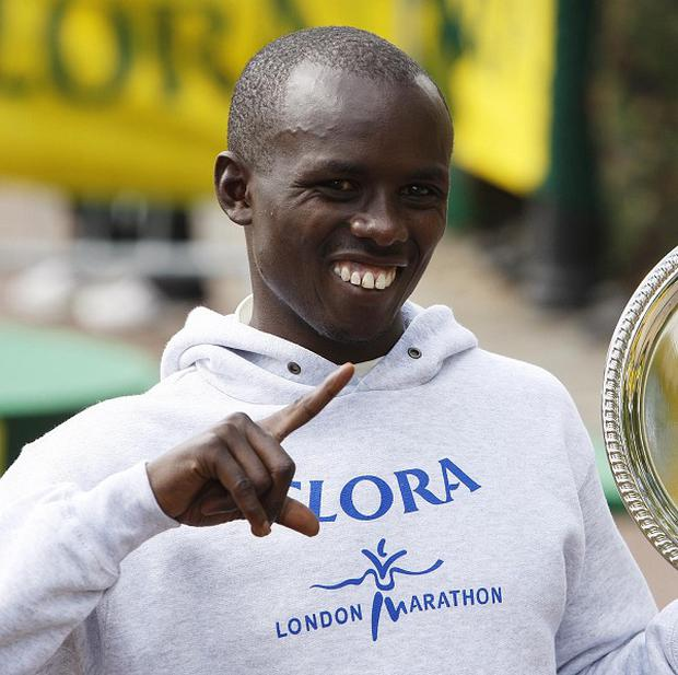 Sammy Wanjiru celebrates following his victory in the Men's race at the 2009 London Marathon