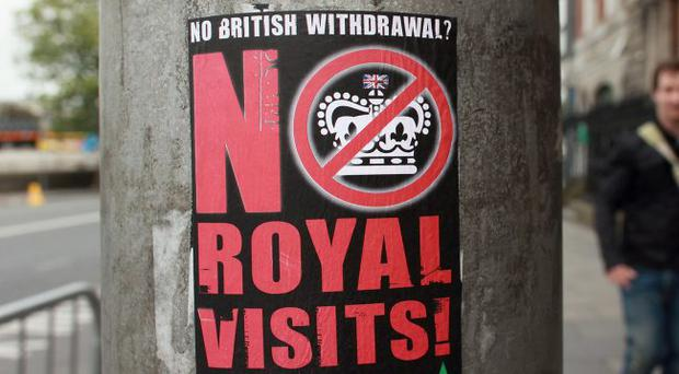 A sticker on a lamppost critical of the state visit to Ireland by the Queen.