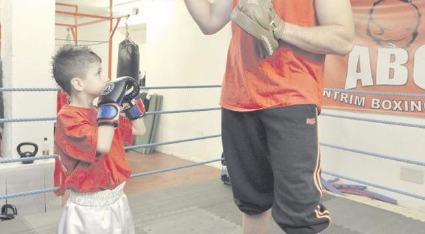 Prospects: British heavyweight title challenger Tyson Fury and seven-year-old Bradley Hodge at Antrim ABC