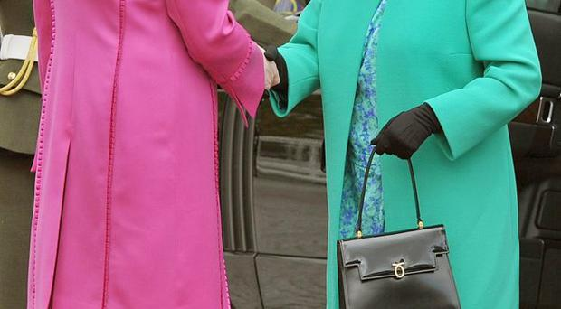The Queen shakes hands with Irish President Mary McAleese after arriving at Aras an Uachtarain (The Irish President's official residence) in Phoenix Park, Dublin, Ireland.