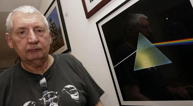 Designer Storm Thorgerson next to his cover of the Pink Floyd album The Dark Side Of The Moon