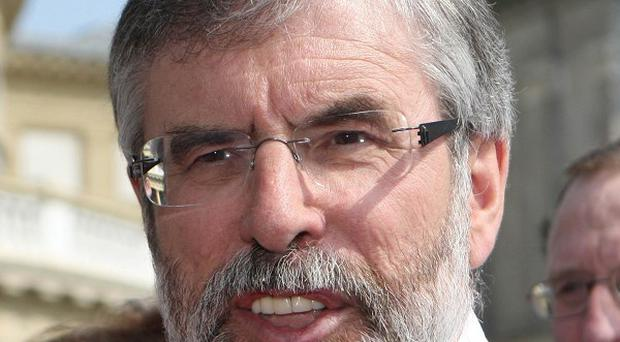 Sinn Fein president Gerry Adams took steps to quit his seat in Parliament after winning the Louth constituency for the Dail